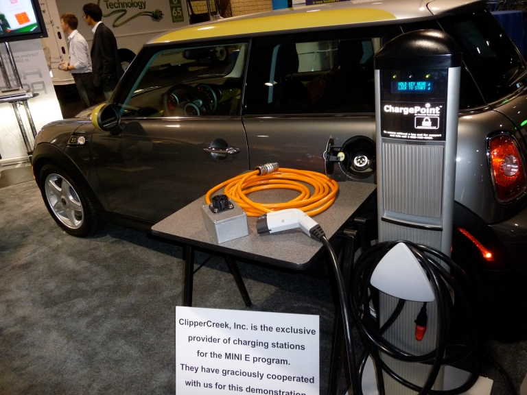 Get to know Coulomb.  They make charging stations and they make good ones.  Their chargers were all over the exhibit floor charging every EV there.