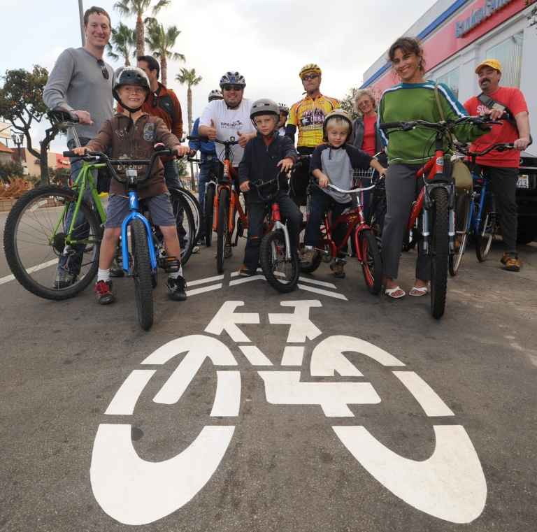 "Members of the newly formed South Bay Bicycle Coalition are happy with the Hermosa Beach ""sharrows,"" which allow bicyclists to use a lane of traffic on Hermosa Avenue. The group hopes to see more South Bay cities install such bicycle-friendly facilities. (Steve McCrank, Daily Breeze Staff Photographer)"