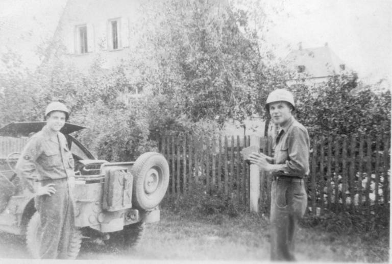 Robert Earl Bushweit (right) runs into his Detroit buddy, Percy, in a captured German town.