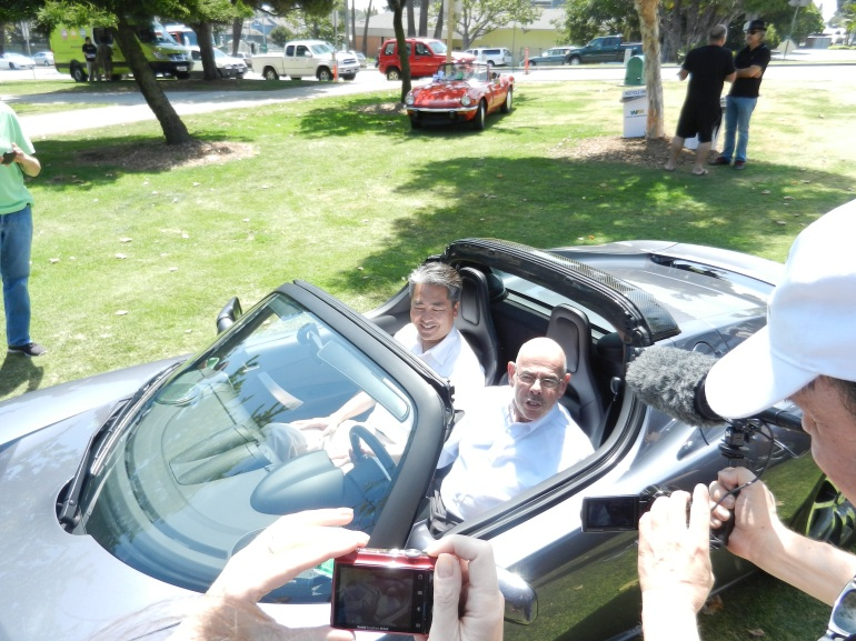 Congressman Waxman in a Tesla, contemplating how fast he could drive away from DC in one of these EVs. (c) Joe Galliani